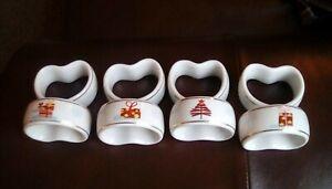 8 ceramic Christmas themed napkin holders.used .