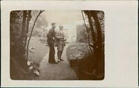 2 cheerful gentlemen  in a garden RP c 1920,  planting out,  jackets     D4/720