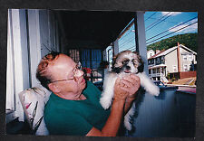 Vintage Photograph Man Holding Up Adorable Little Puppy Dog