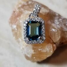 3.2 Carat Sky Blue Topaz .12 CT Diamond Pendant in silver