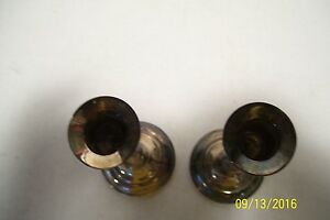 A Pair of Weighted Silver (we think) candle sticks