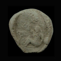 A Phoenician clay bulla the image depicting a lady. e8097
