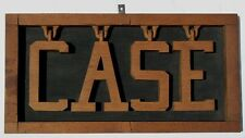"""A very unusual carved whimsey spelling out the word """"CASE"""""""