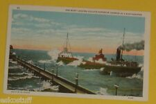Oreboat Leaving Harbor in a Northeaster - Duluth MN 1920s Historic View postcard