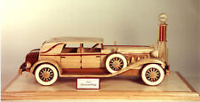 Woodworking plans for building a Duesenberg automobile.  An elegant car in wood