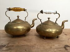 PAIR OF  BRASS TEA KETTLES - AMBER GLASS & PORCELAIN HANDLES