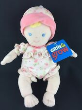 Sassy Grin & Grow Soft Rattle Doll Blonde Hair Blue Eyes Pink Flowers Hat