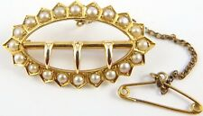 Antique 18 carat Yellow Gold pearl set oval buckle brooch.