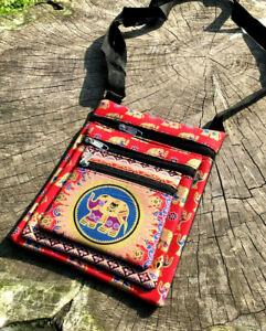 Red multi pocket shoulder bag with gold elephant design and three zip pockets