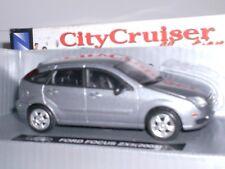 FORD FOCUS ZX5 AÑO 2005 DE NEW RAY CITY CRUYSER ESCALA 1,43 DE METAL CON CAJA