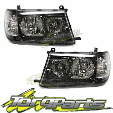 HEADLIGHTS PAIR SUIT TOYOTA LANDCRUISER 100 SERIES 98-05 ALTEZZA BLACK ONE PIECE