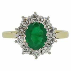 Preowned Oval Emerald and Diamond Claw Set Cluster Ring 18ct Yellow And White...