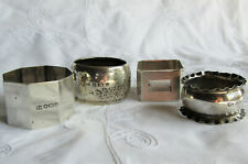 More details for a small collection of four hallmarked silver napkin rings