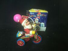 Vintage Tin Santa on a Tricycle with Balloon Made in Korea