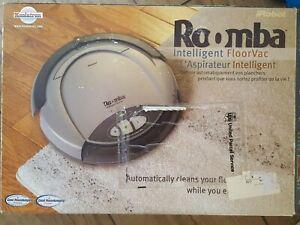 IROBOT ROOMA INTELLIGENT FLOORVAC ROBOTIC VACUUM