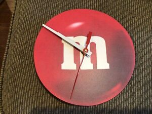 """M&M Wall Clock featuring """"M"""" Red."""