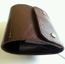 .223/.204/.222. 10 round Bullet wallet. Brown real leather. With studs.