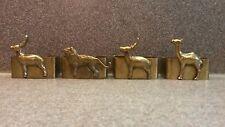 VINTAGE BRASS NAPKIN RINGS WILD ANIMAL LION CAMEL DEER OR ELK