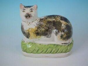 Staffordshire pottery cat figure