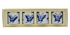 A set of 4 boxed napkin rings Blue & white butterfly design