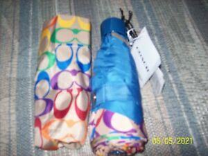 NWT Coach mini umbrella new rainbow signature on tan background