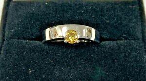 Custom Platinum & 1/3cts Intense Fancy Yellow Round Brilliant-Cut Diamond Ring