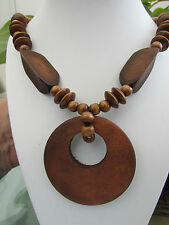"""A CHUNKY MID-BROWN WOODEN BEAD STRETCH NECKLACE. 20"""" + EARRINGS & BRACELET."""