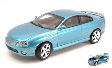 Pontiac Gto Coupe' 2004 Metallic Blue 1:18 Model AMM1025 AUTO WORLD