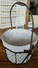 "Metal basket, white cloth liner, brown ribbon, 9 3/8"" x 6 3/4""h, 15"" total h."