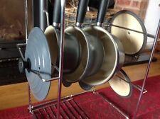 Le Creuset cast iron graphite grey pan set on chrome stand, (16 18 20 )