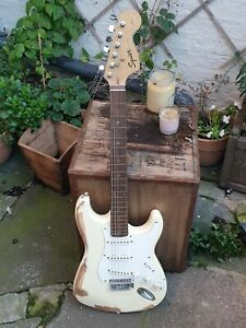 Squier by Fender Roadworn/Relic Stratocaster in Olympic White Guitar