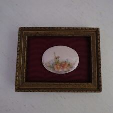 Hand painted miniature porcelain oval plaque in vintage gold frame  florals
