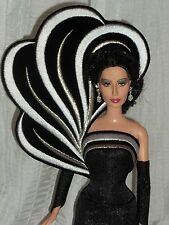 Cher Barbie Doll that has received a partial repainted/ Bob Mackie Gown