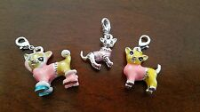 Pretty set of three chihuahuas wearing a pink sweater charms with lobster claw