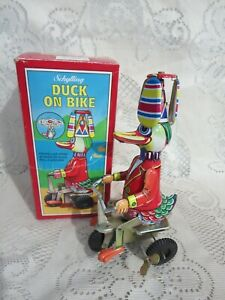 Schylling Duck on Bike Wind Up Tin Toy Hat Propeller in Box