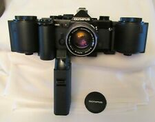 Olympus OM-2N Black Beauty w/ 250 Film Back 1, Grip, Fast 50mm 1.4 Zuiko lens