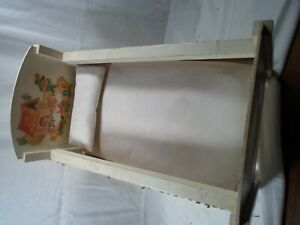 antique toy doll bed with mattress and pillow