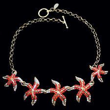 Collier mit Seesternen und korallenfarbenen Perlen, goldfarbenes Metall