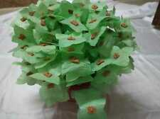 Handmade plastic flower for home decoration in green color