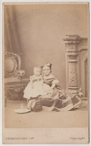 """Dwarf CDV-Lavinia Warren and her """"baby"""" with concertina on floor"""