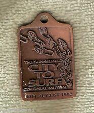 #D70.  1992  CITY TO SURF FOOT RACE PENDANT