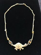 gold coloured metal turtle tortoise necklace with amber and green stones