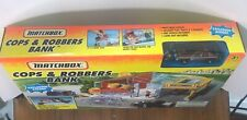 NOS Matchbox Cops & Robbers Exploding Coin Bank w/Police Car, Figures New