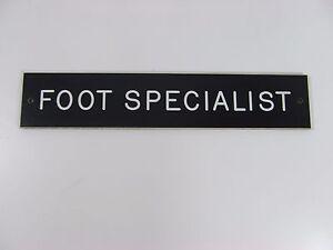 """FOOT SPECIALIST SIGN/PLAQUE WALL OR DOOR MOUNTED BLACK PLASTIC 8"""" X 1 3/4"""""""