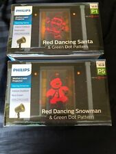 Phillips Motion Laser LIght Projector Red Dancing Snowman & SANTA LOT OF 2 NIB