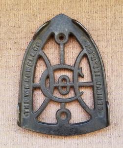 W H Howell Co. Cast Iron Sad Iron Trivet, Geneva Ill, USA