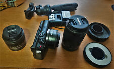Canon EOS M100 Camera with lenses: Canon EF-M15-45mm, EF-M 22mm, EF-M 55-200mm