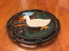 TRIVET ROUND SHAPED WITH DUCK DESIGN CAST IRON