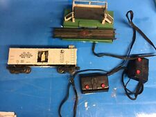LIONEL POSTWAR Operating Milk Car #3472 + Platform , track & buttons