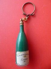 Lot de 6 porte-clés pub.  2x VITTEL - PERRIER - champagne COUDER - café LABRADOR